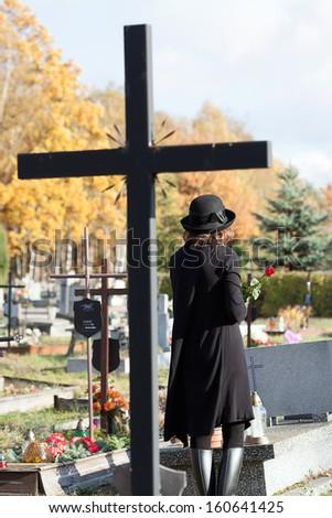 Cross as a symbol of catholic faith in post mortem life - stock photo