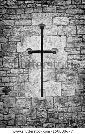 cross as a window or opening in a church wall - stock photo