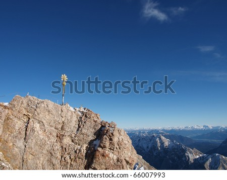 Cross at highest mountain from Germany Zugspitze at Bavaria - stock photo