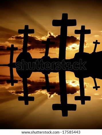 cross at the sunset and the orange clouds - stock photo