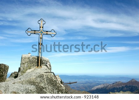 Cross at the top of Gerlach Peak (2655 m) in the High Tatras, the highest mountain in the Carpathians - stock photo