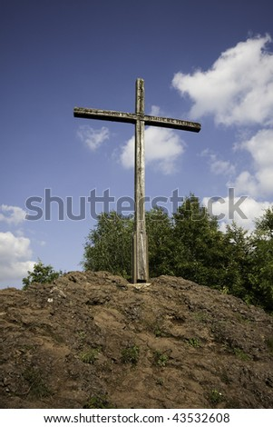 Cross at the volcano crater lake Windsborn (Vulkaneifel, Germany)