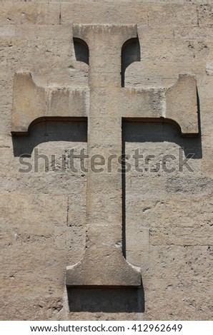 Cross built on the wall. - stock photo