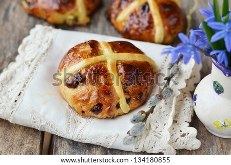 cross buns and snowdrop - stock photo