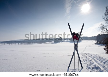 cross country ski trail with ski and chopsticks - stock photo