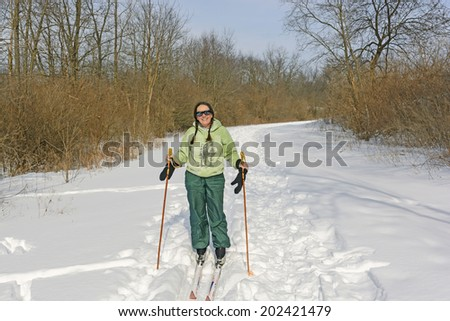 Cross Country Skier on a Sunny Day on Moraine Hills State Park - stock photo