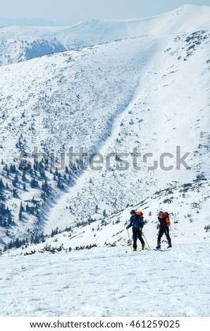 Cross country skiers in a winter mountains