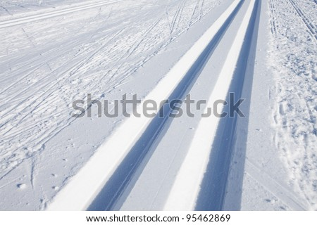 cross country skiing tracks in the winter - stock photo