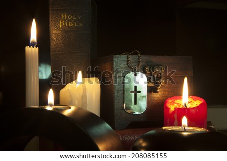 Cross dog tag necklace and Candlelight - stock photo