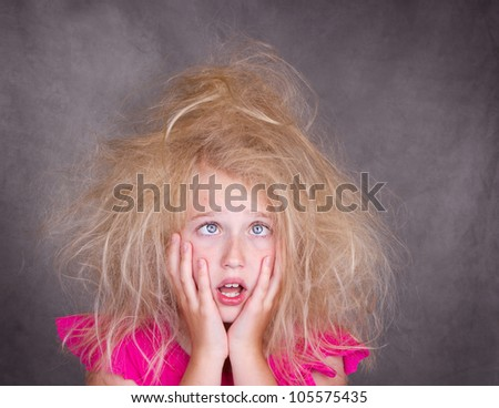 Cross eyed girl with crazy, tangled hair - stock photo