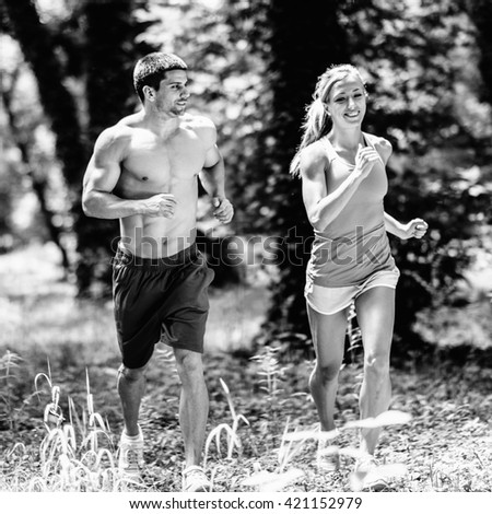 Cross fit athleteic couple jogging