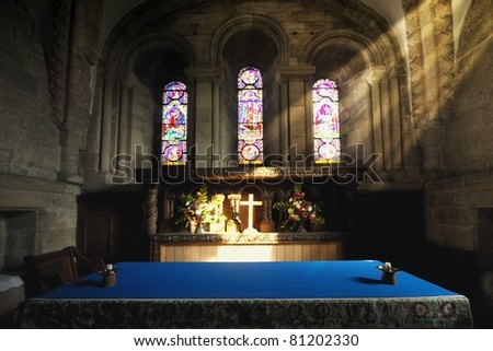 Cross Illuminated At The Altar Of A Church - stock photo