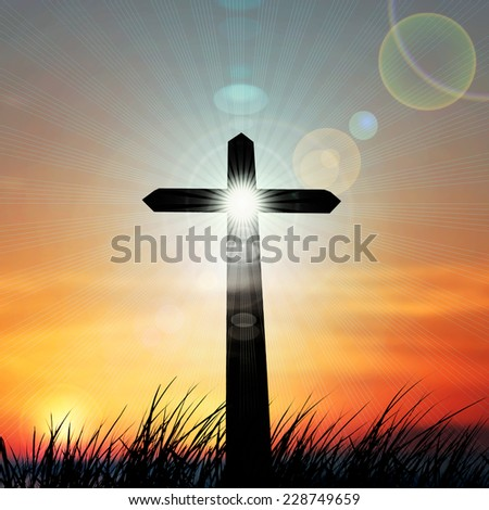 cross in a grass ,sky and sun background