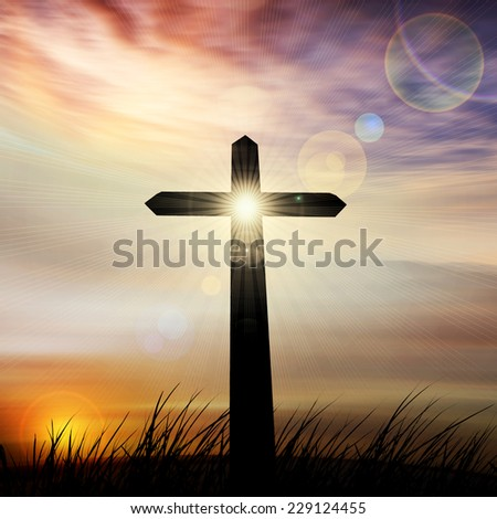 cross in a grass ,sky and sun background - stock photo