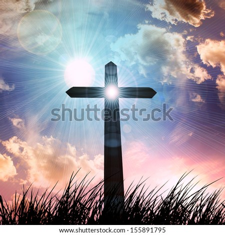 cross, in a grass, sunset sky background - stock photo