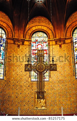 Cross in Boston Trinity Church interior view with beautiful pattern and decoration.