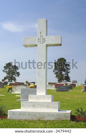 Cross in Cemetery Cemetery on Bright Sunny Day - stock photo