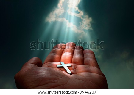 Cross in hand - stock photo