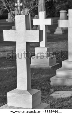 cross in the cemetery - stock photo