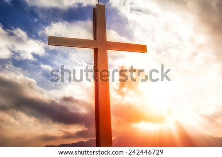 cross in the mountain at the sunset - stock photo