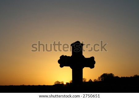 Cross in the sunrise - stock photo