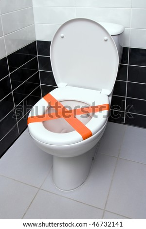 Cross made from adhesive tape, the sign Do not throw trash in toilet - stock photo