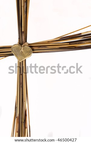 Cross made from brown grass - stock photo
