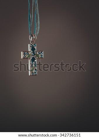 Cross necklace pendant. Christian religion faith symbol. Christianity. - stock photo