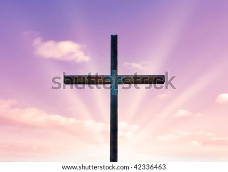 cross of christ in field in front of a pink sky