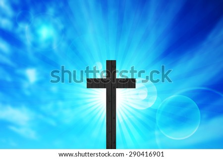 Cross of wood,sun,clouds and sky background