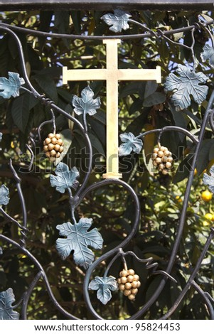 cross on a forged wrought in the Church of the First Miracle.Kefar Cana, Israel - stock photo