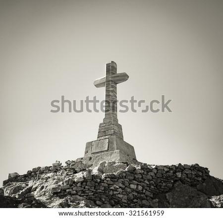 Cross on a high mountain, Tinos Island, Greece. Sepia Color - stock photo