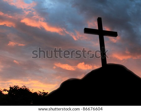 Cross on a hill with cloudy background - stock photo