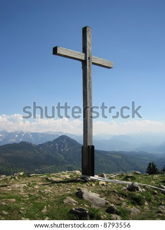 Cross on a mountain. It is expressive. - stock photo