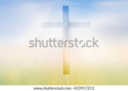 cross on blurry sunset background - stock photo