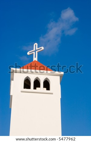 Cross on church with blue sky background