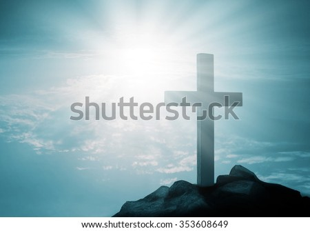 Cross on hill at sunset  - stock photo