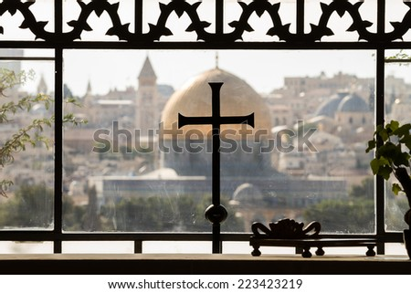 Cross on mosque in Jerusalem - stock photo