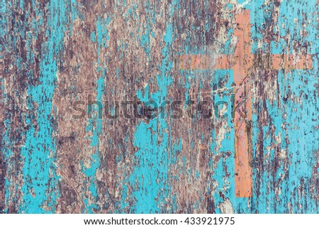 cross on retro old peeling color of wall  - stock photo