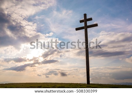 Cross on sky sunset background
