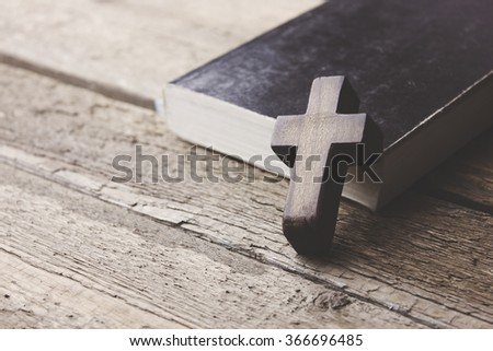 cross on the  book background