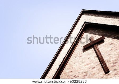 Cross on the front of a building or church - stock photo