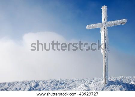 Cross on the mountain peak - stock photo