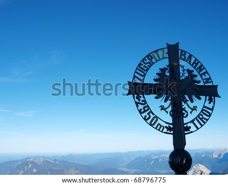 cross on the summit of a mountain - stock photo