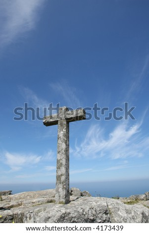 cross on top of the mountain - stock photo