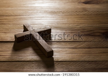 Cross over  wood table with window light - stock photo