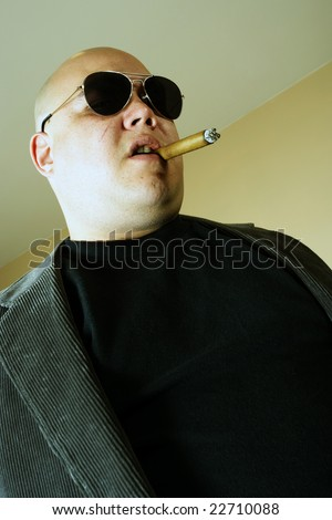 Cross-processed image of a mobster, gangster, or boss. Harsh lighting and cross-processing for meaner look. - stock photo