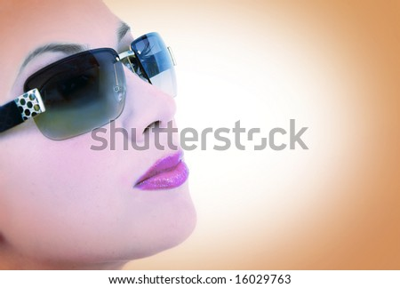 Cross-processed portrait of a beautiful woman wearing sunglasses - stock photo