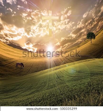 Cross radiates light in sky over beautiful landscape along with figure of light - stock photo