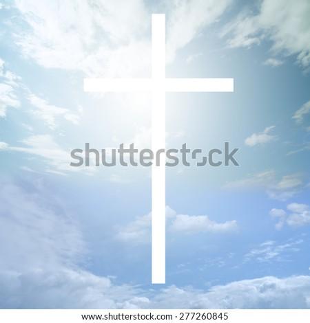 Cross shines bright in the sky - stock photo